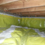 Crawlspace vapor barrier sealed up foundtaion walls and at vents